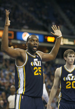 Utah Jazz center Al Jefferson (25) looks for some help from the officials during the second half of an NBA basketball game against the Sacramento Kings in Sacramento, Calif., Tuesday, Feb. 28, 2012. The Kings won 103-96.(AP Photo/Steve Yeater)