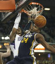 Sacramento Kings forward Jason Thompson, left, dunks over Utah Jazz defender Paul Millsap (24) during the second half of an NBA basketball game in Sacramento, Calif., Tuesday, Feb. 28, 2012. The Kings won 103-96.(AP Photo/Steve Yeater)