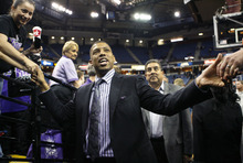 Sacramento Mayor Kevin Johnson is congratulated by fans after the Sacramento Kings beat the Utah Jazz in an NBA basketball game in Sacramento, Calif., Tuesday, Feb. 28, 2012. The Kings won 103-96.(AP Photo/Steve Yeater)