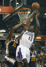 Sacramento Kings guard Tyreke Evans (13) drives to the basket against Utah Jazz defender Derrick Favors (15) during the second half of an NBA basketball game in Sacramento, Calif., Tuesday, Feb. 28, 2012. The Kings won 103-96.(AP Photo/Steve Yeater)