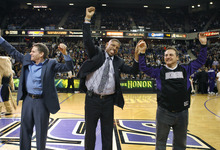 Sacramento Kings owners Joe Maloof, left, and Gavin Maloof, right, celebrate with Sacramento Mayor Kevin Johnson about a tentative agreement to build a new arena and keep the team in Sacramento, at center court during a timeout during the first half of an NBA basketball game between the Kings and the Utah Jazz in Sacramento, Calif., Tuesday, Feb. 28, 2012. (AP Photo/Steve Yeater)