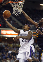 Sacramento Kings guard Isaiah Thomas, left, drives to the basket against Utah Jazz defender Al Jefferson during the second half of an NBA basketball game in Sacramento, Calif., Tuesday, Feb. 28, 2012. The Kings won 103-96.(AP Photo/Steve Yeater)