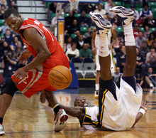 Steve Griffin  |  The Salt Lake Tribune  Utah's Josh Howard falls to the ground after knocking the ball away form Houston's Kyle Lowry during first half action in the Jazz Rockets game at EnergySolutions Arena in Salt Lake City, Utah  Wednesday, February 29, 2012.