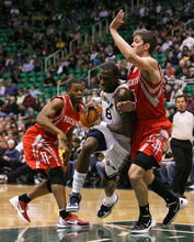 Steve Griffin  |  The Salt Lake Tribune  Utah's Josh Howard lowers his shoulder as he tries to get past Houston's Chandler Parsons during first half action in the Jazz Rockets game at EnergySolutions Arena in Salt Lake City, Utah  Wednesday, February 29, 2012.