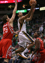 Steve Griffin  |  The Salt Lake Tribune  Utah Jazz guard Devin Harris gets past Houston's Chandler Parsons as he lays in two points during first half action in the Jazz Rockets game at EnergySolutions Arena in Salt Lake City, Utah  Wednesday, February 29, 2012.