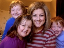 Tracy McKay and her children Jeffrey, 10, left, Abigail, 5, and Eric, 8.