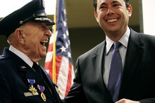 Photo courtesy Mark Johnston  |  The Daily Herald  Rep. Jason Chaffetz laughs with WWII veteran Col. Myron