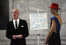 Francisco Kjolseth  |  The Salt Lake Tribune Occupy activists Tim Tracy, left, and Jesse Fruhwirth, introduce the characters in a political theatre production at the Utah Capitol. The performance was intended to mock and protest the close alliance demonstrators say exists between lawmakers the conservative American Legislative Exchange Council, which is backed by big business.