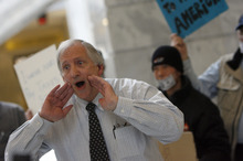 Francisco Kjolseth  |  The Salt Lake Tribune Warren Brodhead, a former high school teacher, lends his voice as he joins Occupy activists in a political theater performance in the Capitol to protest corruption of government.