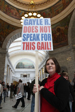 Francisco Kjolseth  |  The Salt Lake Tribune Gail Turpin, 66, holds a sign that distinguishes herself from Utah Eagle Forum President Gayle Ruzika, who opposed an anti-discrimination bill this session. Turpin, a Cottonwood Heights resident, was one of more than 100 people who rallied in the Capitol on Wednesday to show support for Utah's lesbian, gay, bisexual and transgender community. February 29, 2012.