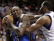 Oklahoma City Thunder center Kendrick Perkins (5) hangs onto the ball as Philadelphia 76ers' Elton Brand, right, reaches for it during the second half of an NBA basketball game on Wednesday, Feb. 29, 2012, in Philadelphia. The Thunder won 92-88. (AP Photo/Alex Brandon)