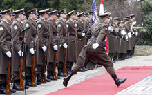 A member of the Croatian honor guards jumps over the red carped before the arrival ceremony for Austria's President Heinz Fischer, in Zagreb, Croatia, Thursday, March 1, 2012. President Fischer is on and official visit to Croatia. (AP Photo/Darko Bandic)