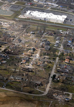 This aerial photo shows a path of damage stretching west from the backside of a Wal-Mart Supercenter to the east in Harrisburg, Ill., after a severe storm hit Wednesday, Feb. 29, 2012. Several deaths have been reported in Harrisburg and left the city's medical center scrambling to treat an influx of injured, the hospital's top administrator said. (AP Photo/The Southern, Steve Jahnke)