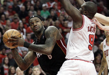 Nam Y. Huh  |  The Associated Press Miami Heat's LeBron James, left, looks to the basket as Chicago Bulls' Luol Deng defends during Game 1 of the Eastern Conference finals on Sunday.
