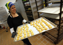 Debora Hammond pulls a fresh batch of Cheese Bread from the oven.