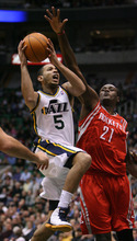Steve Griffin  |  The Salt Lake Tribune  Utah Jazz guard Devin Harris gets past Houston's Samuel Dalembert as he drives to the basket during first half action in the Jazz Rockets game at EnergySolutions Arena in Salt Lake City, Utah  Wednesday, February 29, 2012.