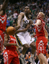 Steve Griffin  |  The Salt Lake Tribune  Utah's Alec Burks passes the ball through the Houston defense during first half action in the Jazz Rockets game at EnergySolutions Arena in Salt Lake City, Utah  Wednesday, February 29, 2012.