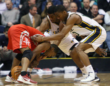 Steve Griffin  |  The Salt Lake Tribune  Utah's Derrick Favors and Alec Burks trap Houston's Kyle Lowry  during first half action in the Jazz Rockets game at EnergySolutions Arena in Salt Lake City, Utah  Wednesday, February 29, 2012.