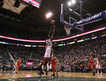 Steve Griffin  |  The Salt Lake Tribune  Utah's Jeremy Evans leaps up for a lob pass during first half action in the Jazz Rockets game at EnergySolutions Arena in Salt Lake City, Utah  Wednesday, February 29, 2012. Evans was fouled on the play.