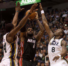 Trent Nelson  |  The Salt Lake Tribune Utah Jazz forward/guard Josh Howard (8) blocks a shot by Miami's LeBron James (6). Utah Jazz vs. Miami Heat, NBA basketball at EnergySolutions Arena Friday, March 2, 2012 in Salt Lake City, Utah. Utah Jazz guard/forward C.J. Miles (34) at left.
