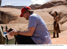 Director Andrew Stanton, left, and John Carter (Taylor Kitsch) on the set of