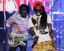 Lil Wayne, right, performs during the Caesars Entertainment