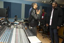 In this photo taken, Tuesday, Feb. 28, 2012, musician Ryan Leslie, left, meets with former NFL football player Darren Howard at the first-ever NFL Business of Music Boot Camp at New York University's Clive Davis Institute of Recorded Music in New York. This week, the league offered an assist to current and former players like Howard who are trying to find their footing in a business that can be just as brutal and unforgiving as football. (AP Photo/Charles Sykes)