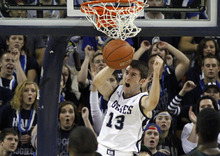 Utah State guard Preston Medlin (13) makes a dunk against Hawaii during the first half of an NCAA college basketball game, Thursday, Jan. 26, 2012, in Logan, Utah. Utah State won 77-72.  (AP Photo/Jim Urquhart)