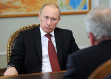 Russian Prime Minister and presidential candidate Vladimir Putin, left, listens to the Minister of Regional Development Viktor Basargin at Novo-Ogaryovo residence outside Moscow on Friday, March 2, 2012. (AP Photo/RIA Novosti, Yana Lapikova, Government Press Service)