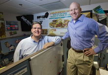 Al Hartmann  |  The Salt Lake Tribune Mindshare's Rich Hanks, left,  and John Sperry pose in a cubicle filled with