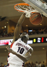 Gonzaga's Guy Landry Edi dunks during the first half of an NCAA college basketball game against BYU at the West Coast Conference tournament on Saturday, March 3, 2012, in Las Vegas. (AP Photo/Isaac Brekken)
