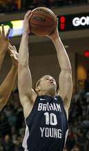 BYU's Matt Carlino pulls down a rebound during the first half of an NCAA college basketball game against Gonzaga's at the West Coast Conference tournament on Saturday, March 3, 2012, in Las Vegas. (AP Photo/Isaac Brekken)