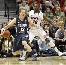 BYU's Brock Zylstra drives past Gonzaga's Guy Landry Edi during the first half of an NCAA college basketball game at the West Coast Conference tournament on Saturday, March 3, 2012, in Las Vegas. (AP Photo/Isaac Brekken)