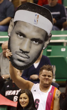 Trent Nelson  |  The Salt Lake Tribune A Miami fan holds up a large LeBron James head. Utah Jazz vs. Miami Heat, NBA basketball at EnergySolutions Arena Friday, March 2, 2012 in Salt Lake City, Utah.