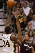 Trent Nelson  |  The Salt Lake Tribune Utah Jazz guard/forward C.J. Miles (34) shoots over Miami's Shane Battier (31). Utah Jazz vs. Miami Heat, NBA basketball at EnergySolutions Arena Friday, March 2, 2012 in Salt Lake City, Utah.