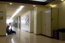 Paul Fraughton  |  The Salt Lake Tribune A student sits in a hallway of Weber State University's Science Lab Building. With few places for students to gather outside the classroom, the hallway floor is the only option. The outdated labs lack a sprinkler system.