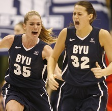 Rick Egan  | The Salt Lake Tribune   BYU's Kristen Riley celebrates with Dani Peterson, after Peterson's shot gave BYU a bit lead, late in the game, in basketball action, BYU vs. Utah, at the Marriott Center in Provo,   Saturday, December 10, 2011.