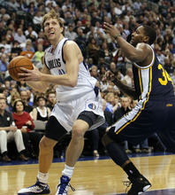 Dallas Mavericks' Dirk Nowitzki, left, of Germany, drives against Utah Jazz's C.J. Miles (34) during the first half of an NBA basketball game, Saturday, March 3, 2012, in Dallas. (AP Photo/LM Otero)