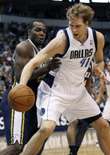 Dallas Mavericks' Dirk Nowitzki (41), of Germany, tries to control the ball against Utah Jazz forward Paul Millsap during the second half of an NBA basketball game in Dallas, Saturday, March 3, 2012. Nowitzki scored 40 points in the 102-96 win. (AP Photo/LM Otero)
