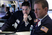 Seth Wenig  |  The Associated Press  Traders work on the floor at the New York Stock Exchange in New York on Tuesday. Stocks suffered their biggest losses of the year Tuesday as a sell-off spread west from Europe ahead of a critical deadline in the Greek debt crisis.