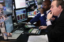 Seth Wenig  |  The Associated Press  Traders work on the floor at the New York Stock Exchange in New York on Tuesday. Stocks in the U.S. are down more than 1 percent at the opening bell, following similar declines in Europe.