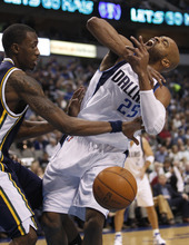 Utah Jazz forward Josh Howard (8) knocks the ball from Dallas Mavericks guard Vince Carter (25) during the first half of an NBA basketball game, Saturday, March 3, 2012, in Dallas. (AP Photo/LM Otero)