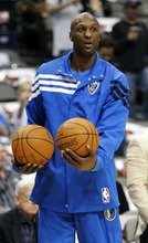 Dallas Mavericks' Lamar Odom (7) warms up for the NBA basketball game against the Utah Jazz,  Saturday, March 3, 2012, in Dallas. (AP Photo/LM Otero)
