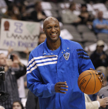 Dallas Mavericks forward Lamar Odom (7) smiles while warming up for the NBA basketball game against the Utah Jazz, Saturday, March 3, 2012, in Dallas. (AP Photo/LM Otero)