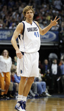 Dallas Mavericks forward Dirk Nowitzki (41), of Germany, after hitting a three-pointer during the first half of an NBA basketball game against the Utah Jazz, in Dallas, Saturday, March 3, 2012. Nowitzki scored 40 points in the 102-96 win. (AP Photo/LM Otero)