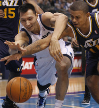 Dallas Mavericks' Yi Jianlian (9), of China, and Utah Jazz guard Earl Watson (11) chase the loose ball during the second half of an NBA basketball game in Dallas, Saturday, March 3, 2012. The Mavericks won 102-96. (AP Photo/LM Otero)