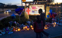 Al Hartmann  |  The Salt Lake Tribune Children pay their respects at a candle memorial at the Emma Carson Elementary School in Puyallup, Washington Monday February 6 for Charles and Braden Powell.