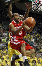 Utah's Chris Hines, left, drives to the basket past Oregon's Olu Ashaolu during the first half of an NCAA college basketball game on Saturday, March 3, 2012, in Eugene, Ore. (AP Photo/Chris Pietsch)