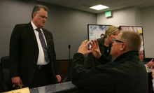 Steve Griffin     The Salt Lake Tribune  Ric Petersen, right, who lives in the Cranberry HIlls area in Draper, expresses his frustration over the Canyons Board of Education's approval of new boundaries for middle schools, with board president Tracy Cowdell, following the board's vote during a meeting in Sandy, Utah Tuesday, March 6, 2012. The plan includes moving Crescent View Middle School from Sandy to Draper.
