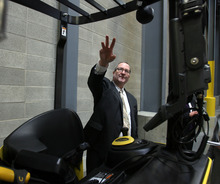 Steve Griffin     The Salt Lake Tribune   Richard Humpherys, manager of the LDS Church's new Bishop's Central Storehouse Salt Lake City, Utah, explains the advanced technology that is involved with the fork lifts at the storehouseTuesday, March 6, 2012.